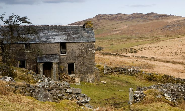 HIGHEST POINT IN CORNWALL: in the background is Brown Willy, the highest point in Cornwall. In the foreground is the abandoned Garrow Farmhouse on the eastern slopes of Garrow Tor on Bodmin Moor.