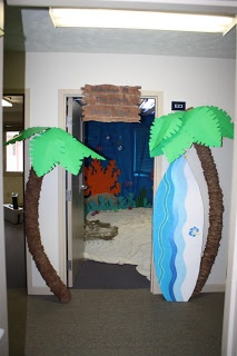 Palm Trees made from pool noodles, smashed down paper bags and poster board attached to coat hangers for the leaves.