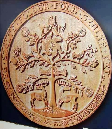 "Vass Tamás, artist. The Hungarian Tree of Life.  Its foliage is the Upper World, and the Turul bird dwells on top of it. The Middle World is located at its trunk and the underworld is around its roots. In some stories, the tree has fruit: the golden apples.  The Middle World is shared among humans and many mythological (often supernatural) creatures, including the Csodaszarvas (""Miraculous Deer"")."