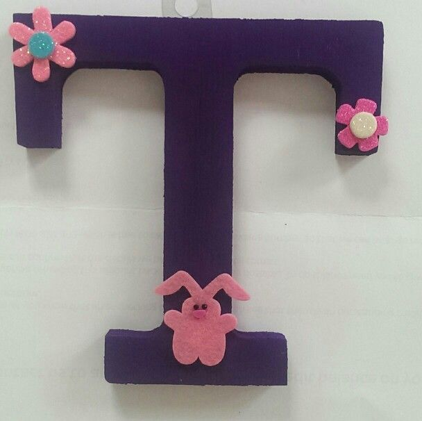 wooden letter Handpainted with acrylic and decorated with stick ons