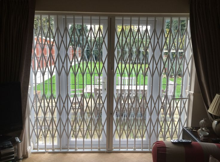 A beautiful picture of our RSG1000 retractable security grilles securing a residential property in Romford.