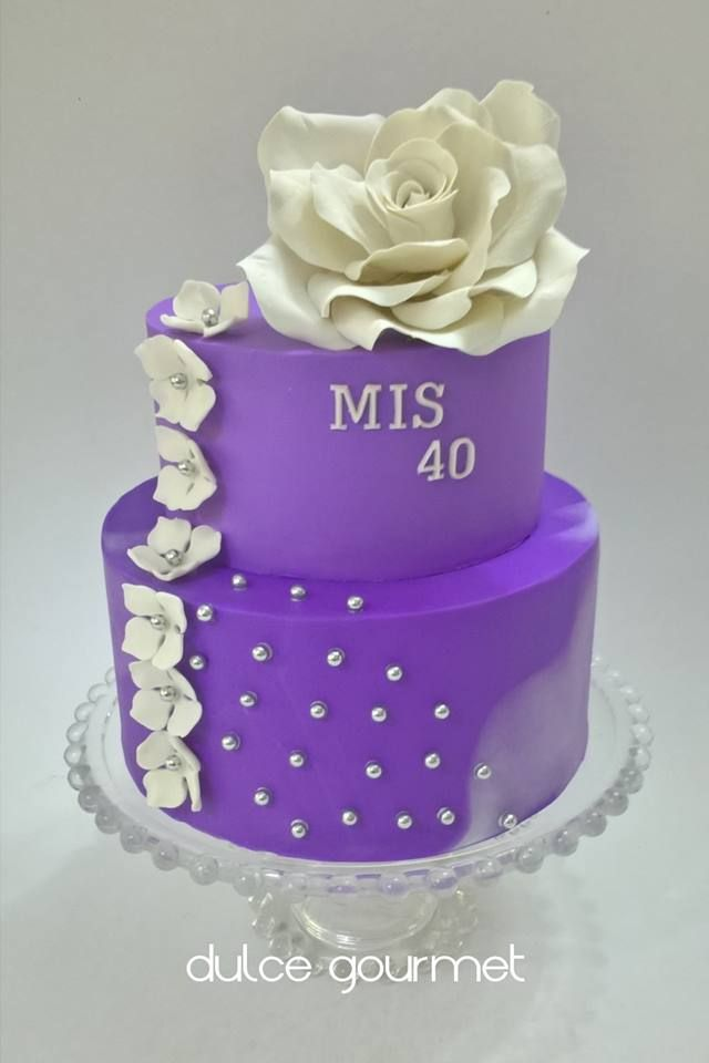 Purple cake with a large sugar rose. 40 th birthday cake
