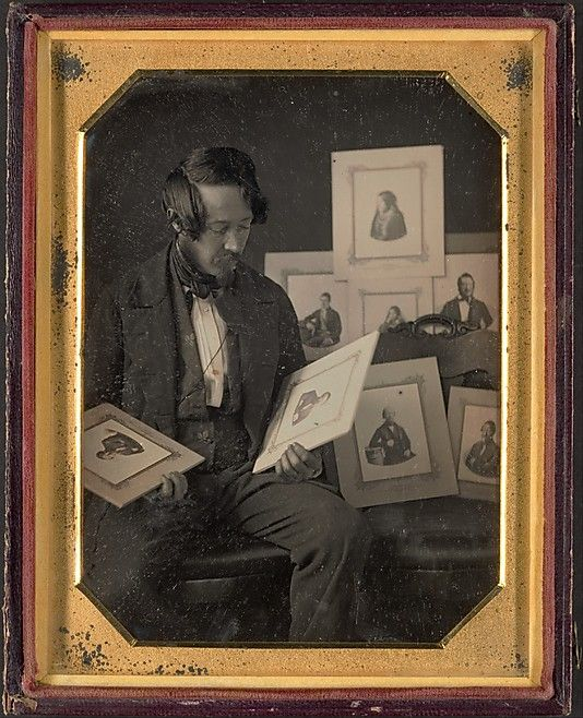 Frederick Langenheim looking at Talbotypes, 1849-51. Daguerreotype.