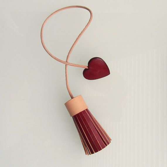 Leather tassel bag charm in deep red hand dyed leather with heart handmade by RinartsAtelier