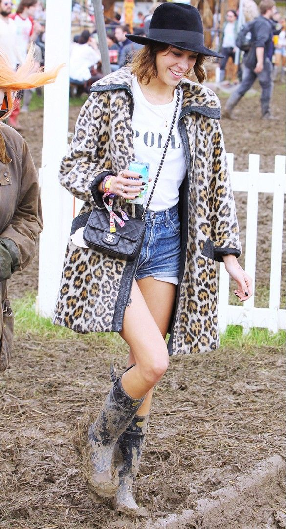 Alexa Chung proved you can do no wrong in cut-offs, a leopard coat, and Panama hat at #Glastonbury 2011 // #CelebrityStyle