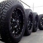 : Black truck rims and tires