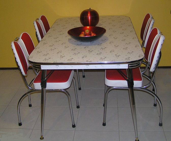 My dining setting after recovering the chairs and upcycling the table. It's awesome and really suits our kitchen well.