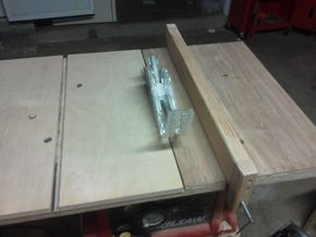 """I bought a small 10"""" table saw from skilsaw, and I really like it, but the table itself was too small for what I wanted to use it for, so I decided to make a larger table out of 3/4 inch plywood. The holes in the table really made it easy to bolt the plywood down (using sunk holes of course). The problem was that this made the fence useless, so I needed to make my own. I played with a lot of ideas and looked for more online, and as always a simple solution arose as the ..."""
