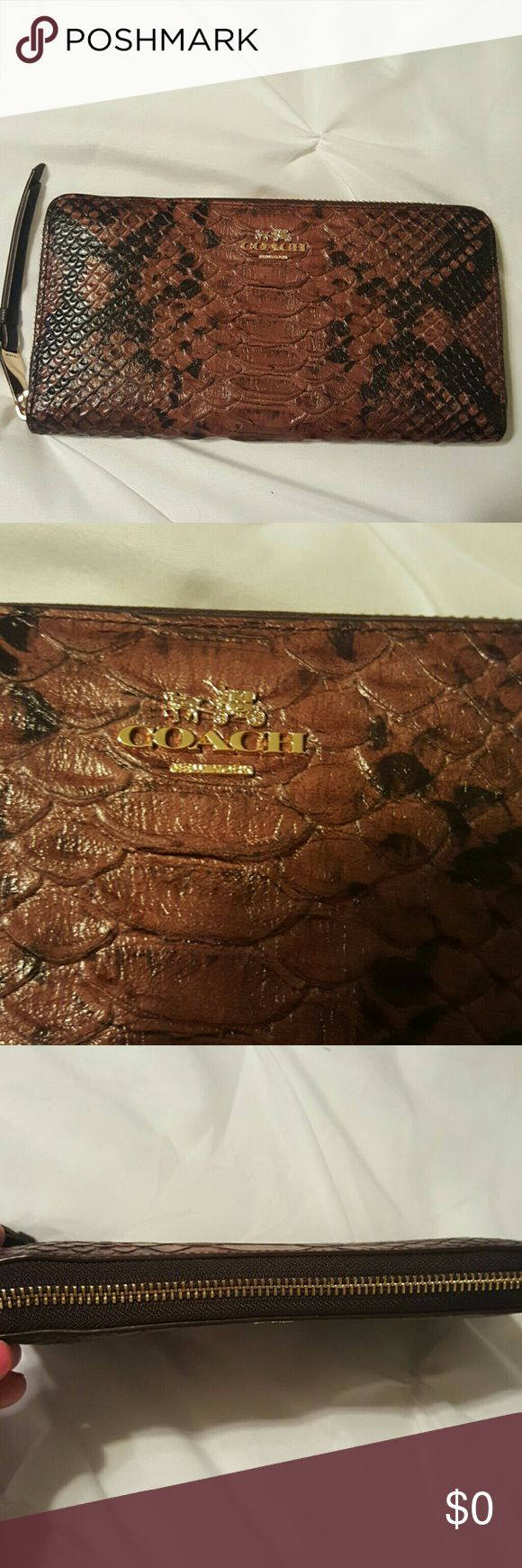 Authentic Coach Wallet Brown and black leather in new condition holds six cards snakeskin Coach Bags Wallets