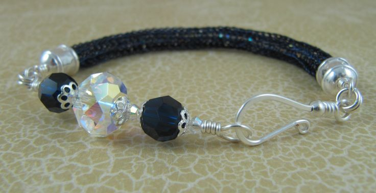 Viking knit weave bracelet with Swarovski crystals inside the weave as well as outside.