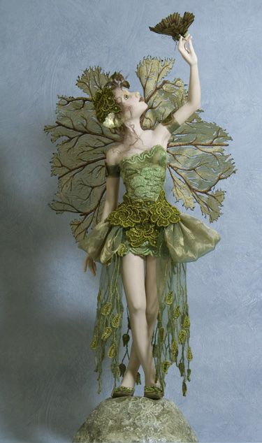 Figure - Hannie Sarris Fairy Fantasy Sculptures - the Wings are magnificent... Like a leafy vegetable or Sea Coral... Ribbon Skirt...