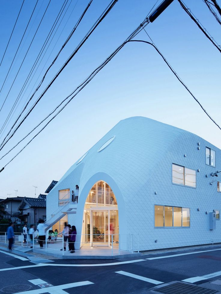 transforms Japanese house into kindergarten with a two-storey slide