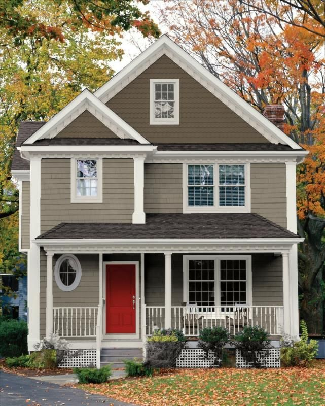 Like the taupe in two shades. White trim very nice. Red door icing on the cake.