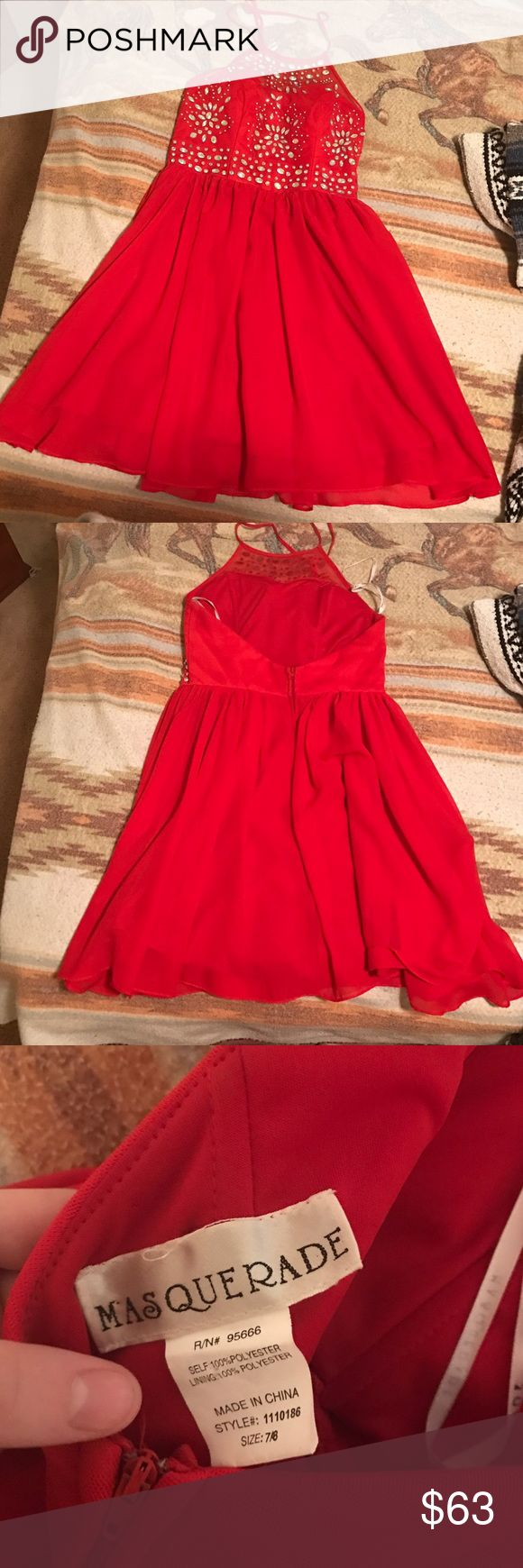 bought it for hoco, no longer need it Beautiful dress comes right above the knee. Has a halter sequin top that zips in the back with a flowy skirt. Size 7/8 in a cherry red. Only worn for a couple of hours. In excellent condition! Price negotiable :) Dresses
