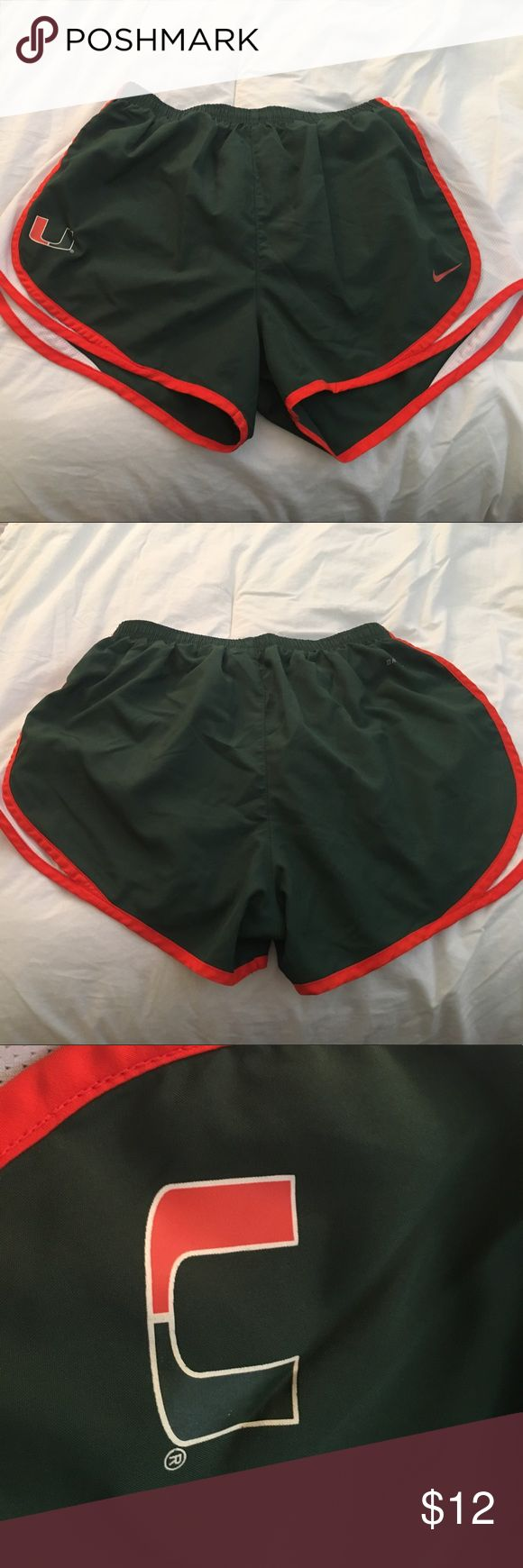 Nike Dri-Fit University of Miami Running Shorts Nike Dri-Fit University of Miami Running Shorts, Size Medium, U of Miami logo on front left, Nike symbol on front right, built-in lining, elastic waist with drawstring to adjust, small pocket for keys and credit cards on front right (when wearing the shorts - see last photo) Nike Shorts