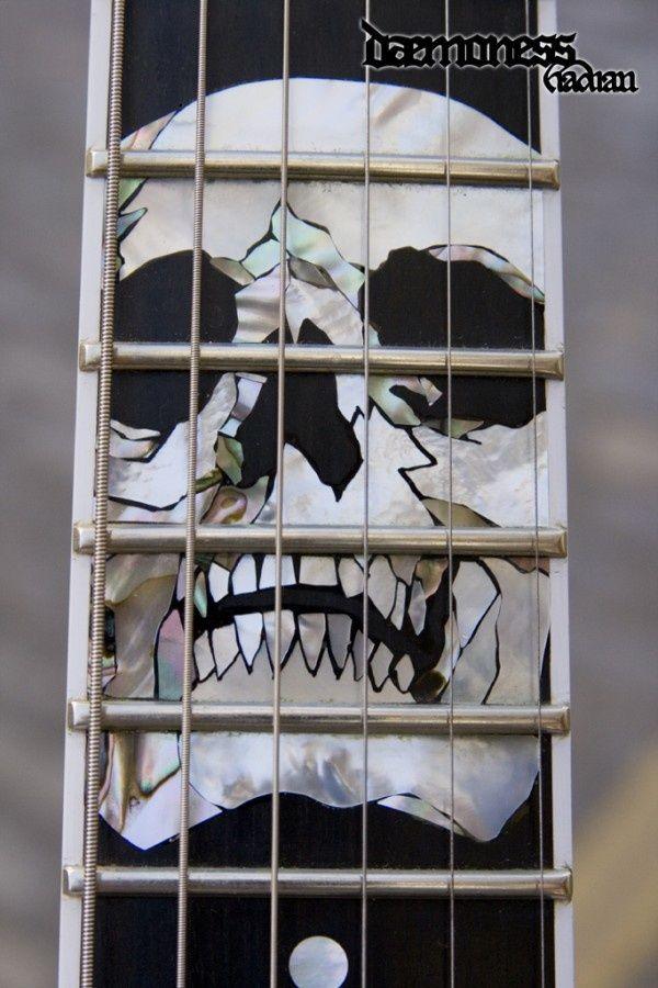 Daemoness Guitars skull inlay.