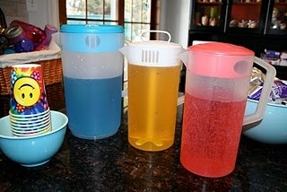 colored Sprite-RED, BLUE, and  YELLOW  (with food coloring)  mix and pour their drink to any color they like  (red, orange, yellow, green, blue, purple,  even brown!)