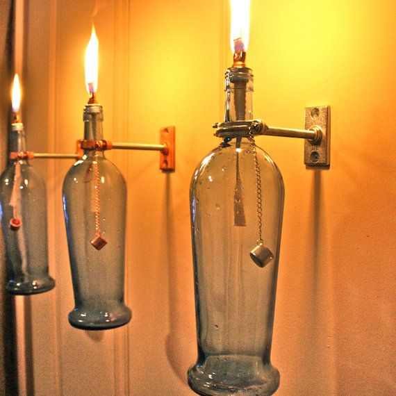 hanging oil lamps from wine bottles @Kim Rowden