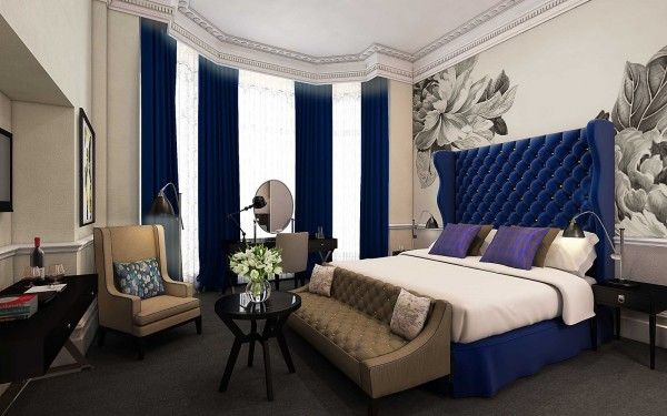 Luxurious Bedroom Decoration Exposed Glamorous Master Bed In Dark Blue Accent With Brown Sofa And Arm Chair Plus Rounded Coffee Table Also High Ceiling Window Feat Deep Blue Curtain For Modern Victori