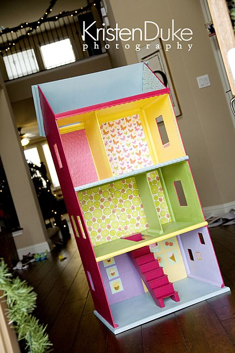 Check out this Dollhouse! Reminds me of my childhood. One year for Christmas my dad built me the most awesome miniture doll house ever! That year my sister got the Barbie magical mansion, cause Barbies were her thing. I so wish I still had that doll house dad built so I could pass it along to my girls. Love the modern, and fun colors used in this doll house.