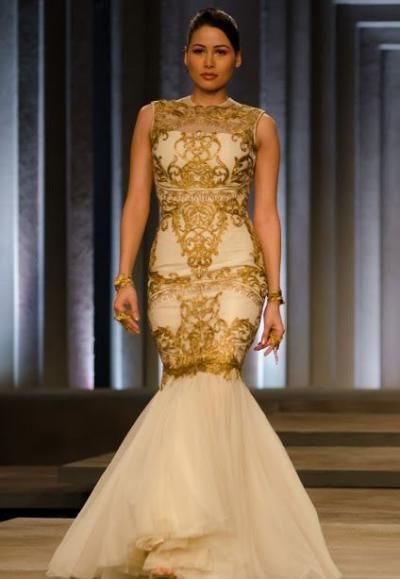 Going modern are Shantanu-Nikhil with this gold-ivory outfit- apt for your engagement or reception.