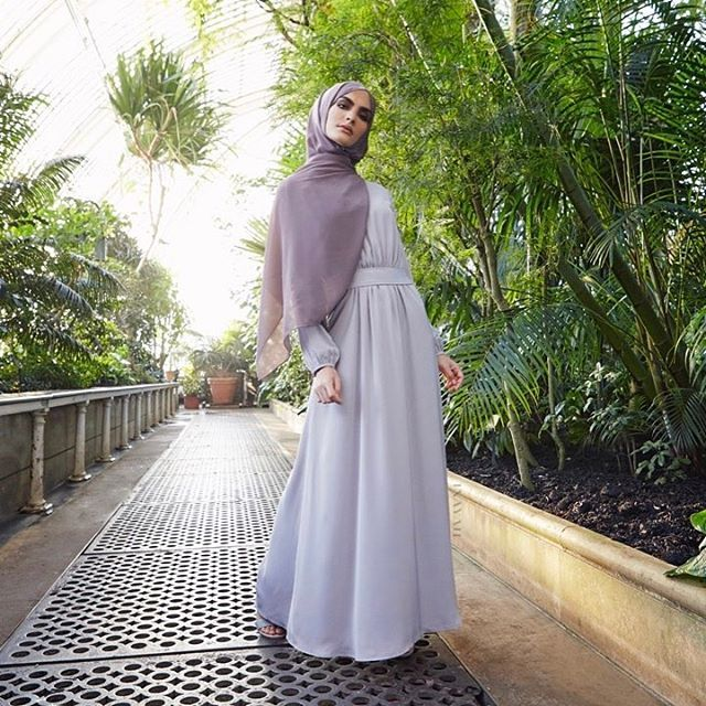 A classic maxi dress in a soft lilac grey, featuring delicate detailing for subtle definition. Ava Belted Maxi Dress in Washed Lilac Grey Ash Soft Crepe Hijab Oatmeal Jersey Drawstring Hijab Cap Large Black Velvet Scrunchy www.inayah.co