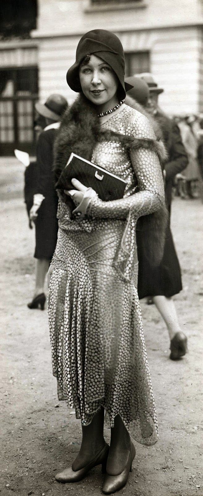 a stylish woman at the longchamp races in paris 1929