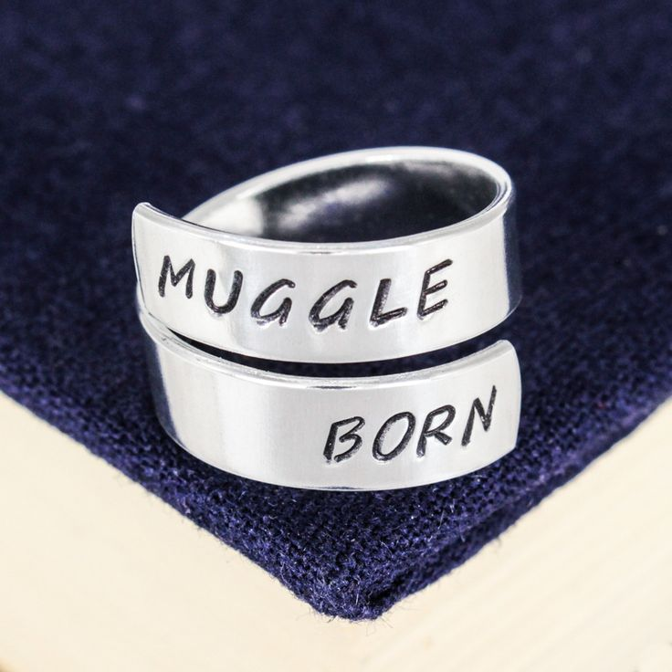 """Inspired by Harry Potter, this """"Muggle Born"""" aluminum wrap ring is hand stamped with care, one letter at a time. The rings are made out of Pure 1100 Aluminum, which is food safe and does not tarnish."""