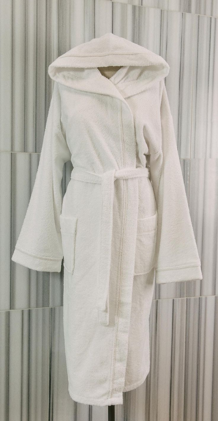Our uniquely designed bathrobe is made from 100% Turkish cotton loomed to a 340 gsm weight.  A distinctive hood offers additional warmth and moisture absorption across the neck and head, while tone on tone piping gives the robe an elegant look. The design also features two patch pockets and a belt with two loops  - See more at: http://www.talesma.com/eng/101/talesma--terry-hooded-bathrobe.html#sthash.KpmKfxvp.dpuf