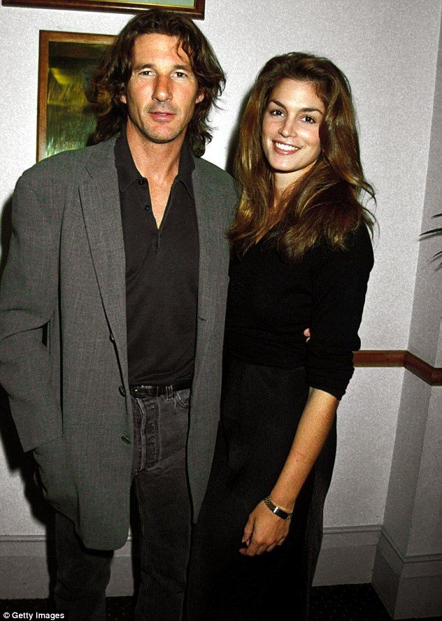 'We don't really see each other that much': Cindy Crawford said during an interview on Thursday that ex-husband Richard Gere is 'like a stranger' to her now. They are pictured in 1991, the same year they married