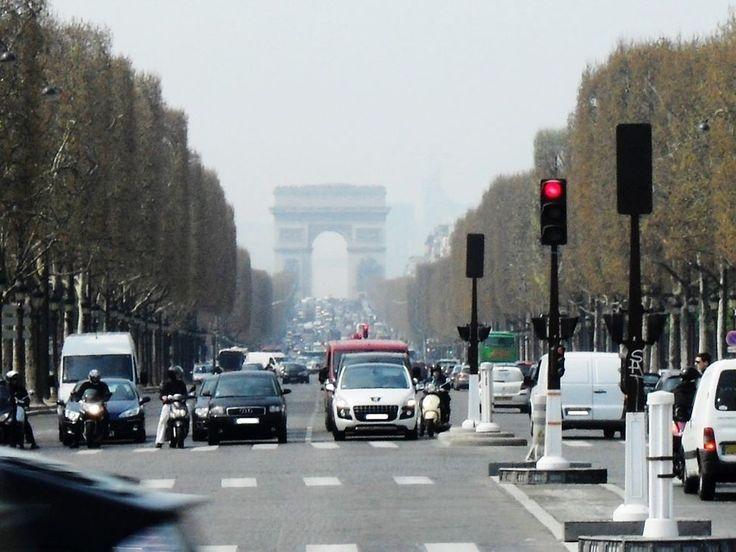Approaching Arc de Triomphe Paris France on a hazy humid midsummer afternoon. #arc #travel #Paris #France #street #streetlight #crosswalk #traffic #StreetPhotography #avenue