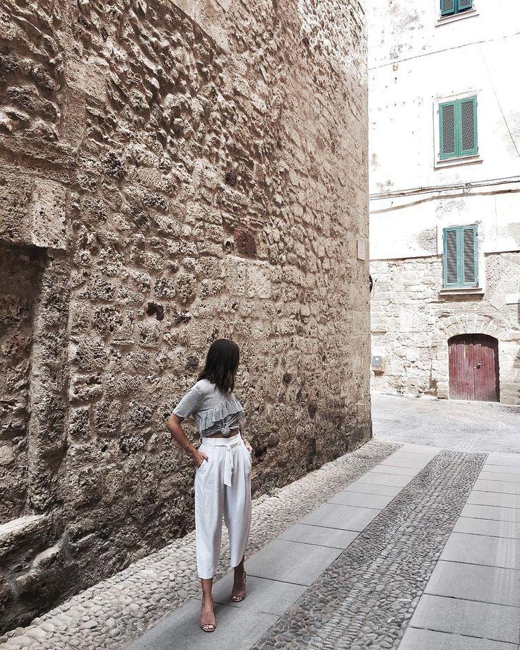 "Sardinia ""Always exploring ... 🌎 Shop my blush pink mules, link in bio #alghero #sardinia #italy"""