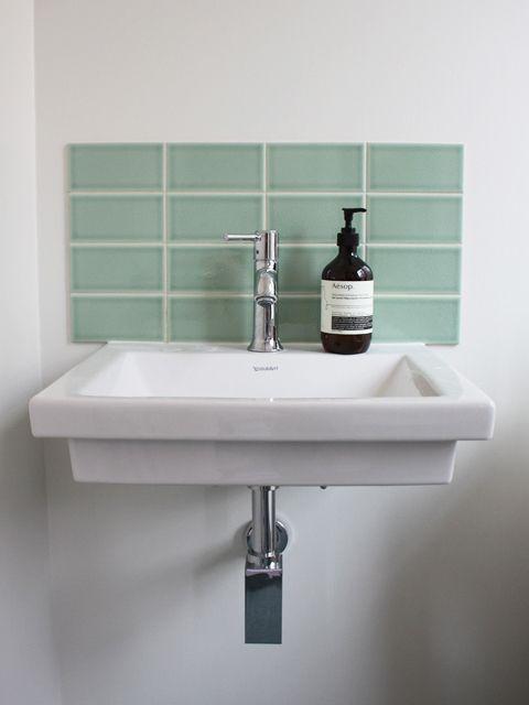 Downstairs loo Sink raised off floor with small splash back