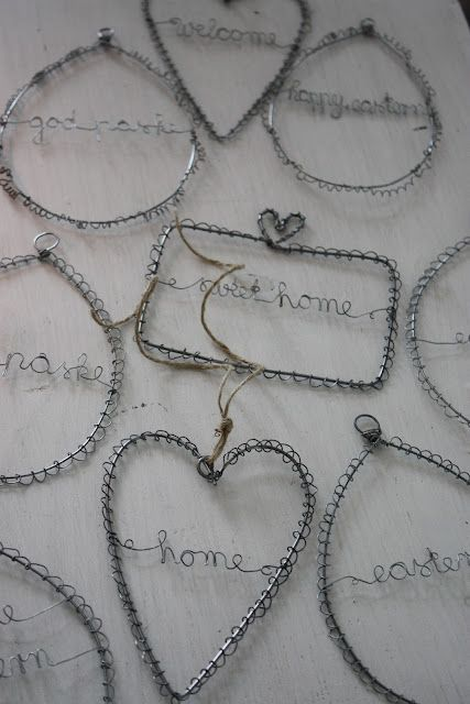 okay .... imagine a peace sign made of wire like this ... on the front door at Christmas.  Maybe!