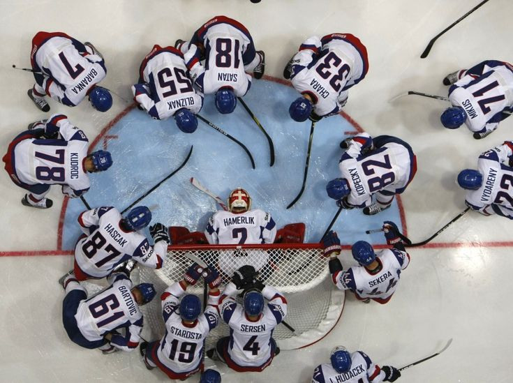 Slovakia's team players gather near their goal before their 2012 IIHF men's ice hockey World Championship Group H game against the Canada in Helsinki, Finland.