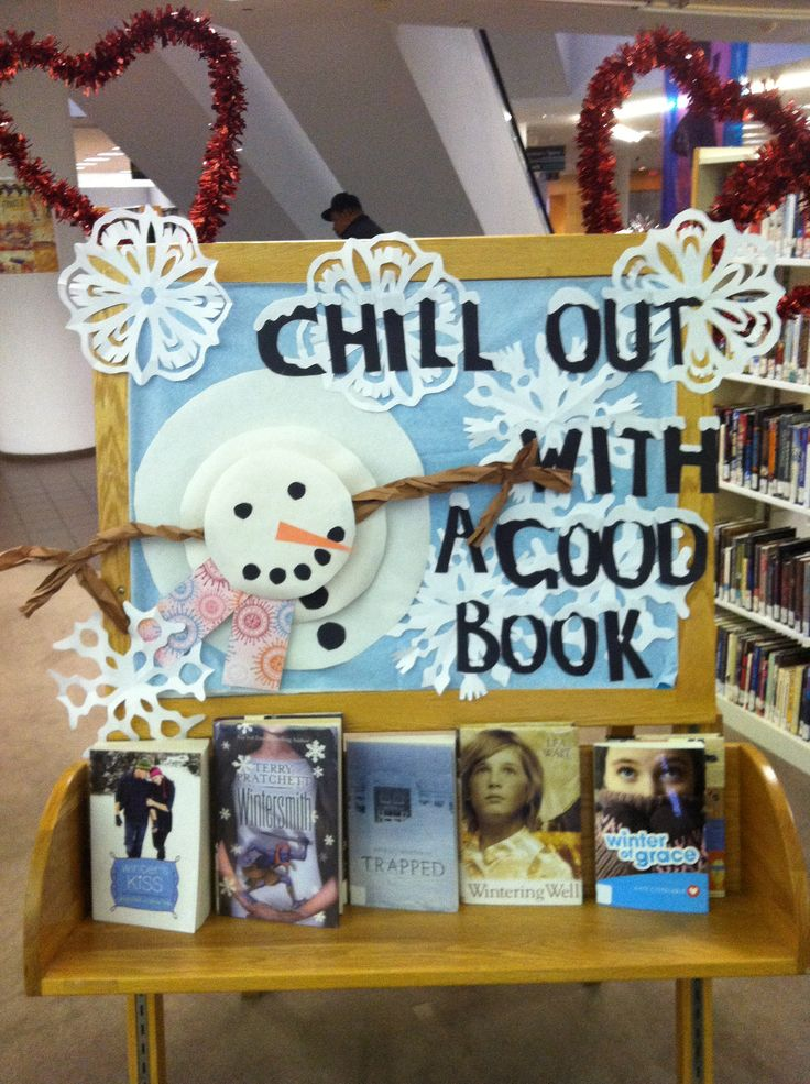 Winter display for the library, with cut out snowflakes and a snowman