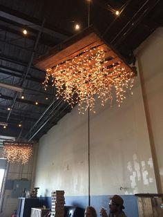 rustic wooden palette wedding chandelier / http://www.himisspuff.com/rustic-wood-pallet-wedding-ideas/7/