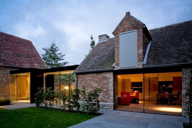 Traditional bricks work well with modern glass doors