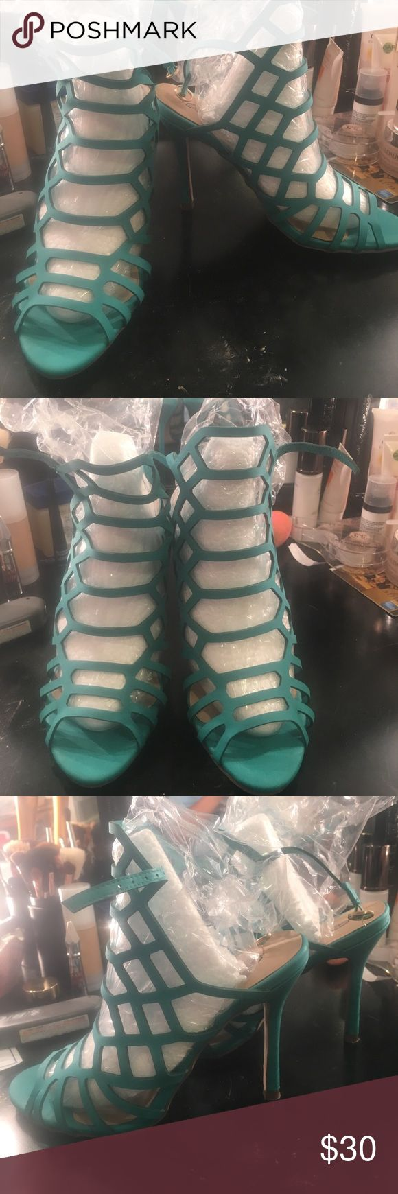 """Turquoise caged shoes Got these last pairs that was the """"show"""" one that's why there are a few marks on soles. But I've never worn since I bought it. Cute. Surpassingly comfy. Shoes"""