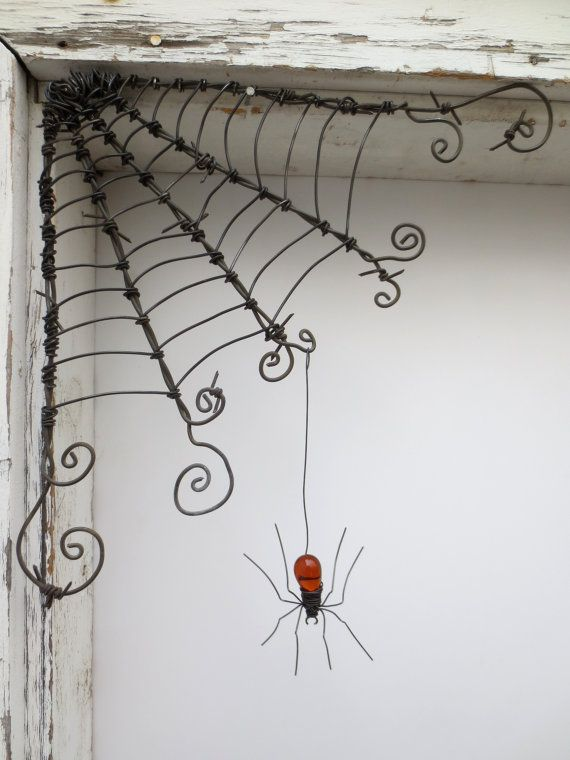 "Do you have a lonely corner that needs a bit of something unusual? How about a spider web with a delicate inhabitant?  I will make you a web and spider very similar to this one.  The beautiful orange spider hangs by a hook on the end her wire thread and can be repositioned where desired. Hang this web in your window, on a door, porch, barn or shed….. inside or out! I used vintage barbed wire in creating this web. Rain and snow will add to the great rusty look.  Measures about 12"" X 12"".  The…"