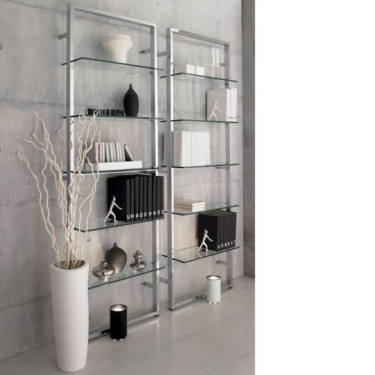 "cb2 ""Tesso Bookcase"" Five polished clear glass shelves niched in gleaming chrome scale the wall to dramatic heights.  Modern étagère reflects light, looks light—but plated metal tube frame wallmounts super sturdy."