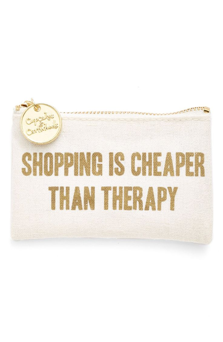 This whimsical coin purse stamped with the motto 'Shopping Is Cheaper Than Therapy' in gold is too cute. It will make the perfect gift for the girl who loves to shop!