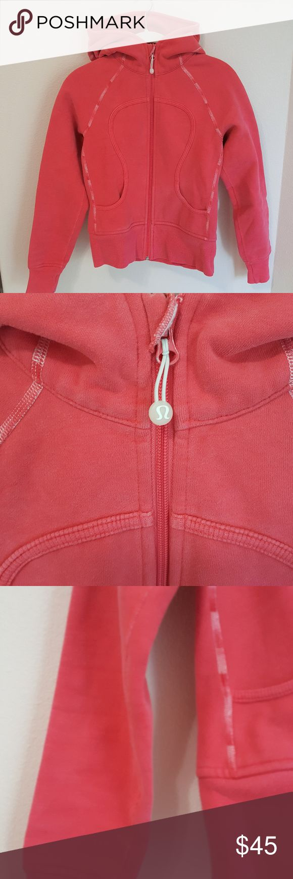 Lululemon Scuba Hoodie This heathered red Scuba is so cute. It's one of the older versions so it is a bit shorter and doesn't have the thumbholes, but the seams have this amazing hombre effect on them that I love. I bought this from someone else without seeing it in person so I was frustrated when the photos represented it as a bright red and was listed as a size 10 with tags removed. Really it's a dusty, heathered red and fits more like an 8. But very cute! lululemon athletica Tops…
