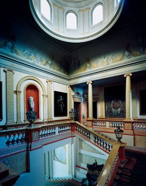 Visitors to the Palacio de Liria ascend a monumental domed stairway, designed by Sir Edwin Lutyens during an early 20th-century restoratio