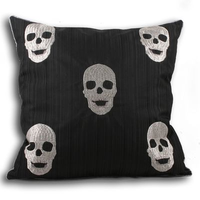 A funky silver skulls design on a black cushion will make a fashionable addition to your sofa or bed.