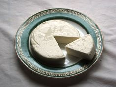 "Wiki: Spanish: Queso Blanco (cow) & Queso Fresco (cow&goat) or White Cheese: Creamy, soft, mild, unaged ""Bag Cheese."" Similar to Pot & Farmer Cheese, Quark, Paneer. Easy to make: Heat whole fresh milk to near-boiling, add acidifier (vinegar), stir to form curds, hang 3-5 hrs in cheesecloth bag to drain; or Queso Seco: press out whey. Melt Queso Oaxaca on quesadillas. Soup, salad, enchilada, empanada topping. Cheesecake in France. Mexico, Brazil, Peru, Portugal, Spain. - Wikipedia"