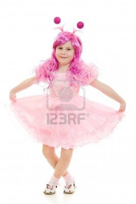 A girl with pink hair in a pink dress dancing on a white background. Stock Photo - 12035229