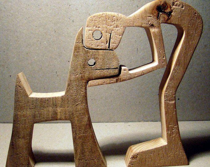 """sculptuur van hout geschulpte """"een man een hond"""""""