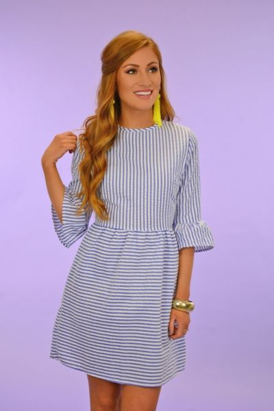 $36.00 Darling Striped Dress This dress is as charming as you can get! It has an a-line shape that is tailored through the waist before falling into a flattering, flared skirt! It has a darling blue and white striped print and ruffled sleeves.