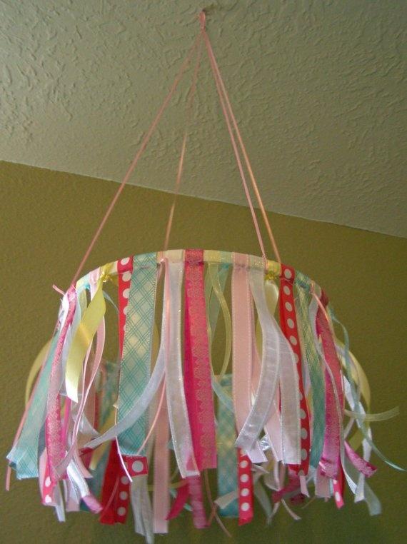 very girly ribbon mobile(could be cute with boy colors for a boys room?!)